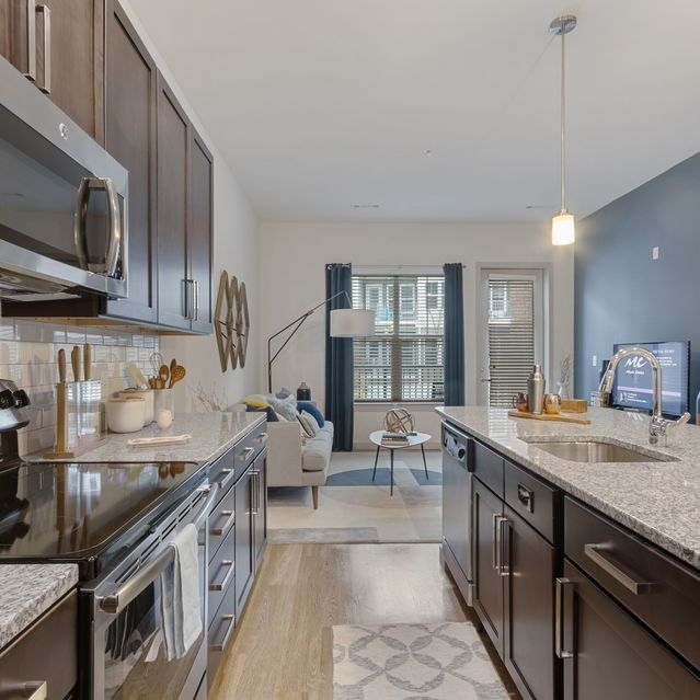 The Slate at Andover -  Stainless steel appliances including built-in microwave and Polished granite countertops