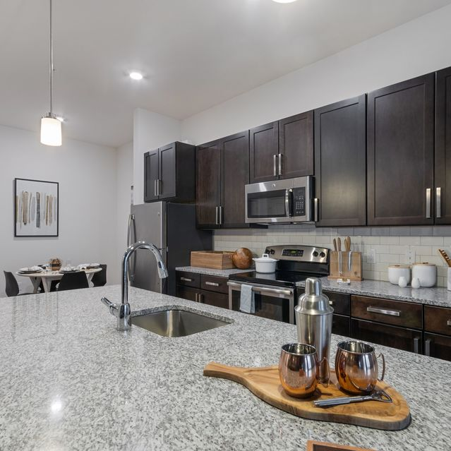 The Slate at Andover -  Wood-style plank flooring in kitchen and living areas